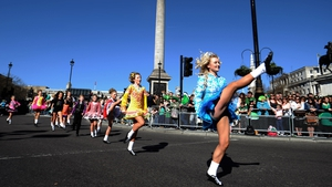 Dancers participate in the St Patrick's Day Festival as it passes  Trafalgar Square in London