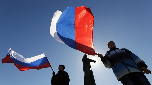 People hold Russian flags as they celebrate the referendum result at the central square in Simferopol, Crimea (Pic: EPA)