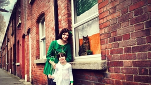 "Eileen O'Gorman, her 4-year-old daughter Bébhinn Berube, and their cat ""Puss"" in front of their house in the Liberties, Dublin 8"