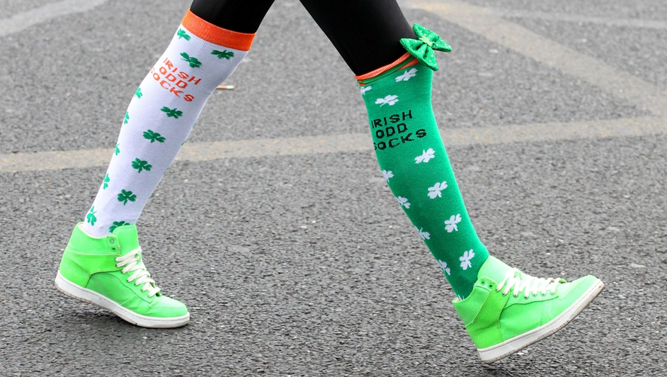 A spectator wearing festive socks attends the St Patrick's Day parade in Dublin city centre