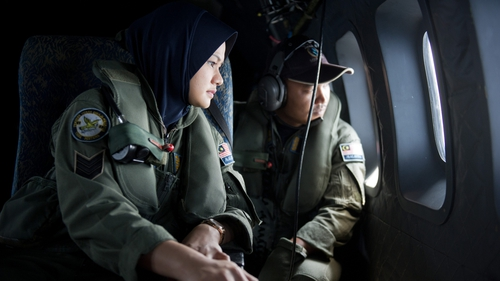 Crew members from a Malaysian Air Force aircraft during a search over the Strait of Malacca