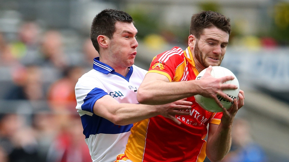 Gerard McDonagh and Michael Concarr battle for the ball