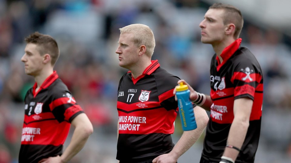 Mount Leinster Rangers look on dejected as Portumna celebrate