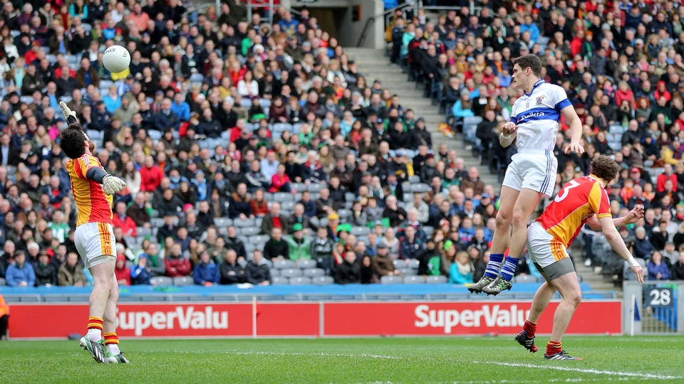 Diarmuid Connolly rises highest to score a goal