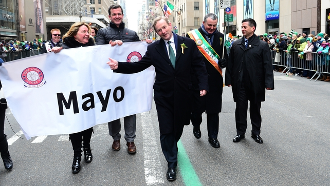 Taoiseach Enda Kenny marched in the New York St Patrick's Day parade despite controversy over LGBT rights