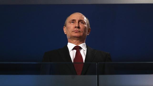David Cameron accused Vladimir Putin's Russia of arming and training thuggish militias