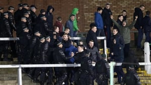 Police stand between supporters at The Oval
