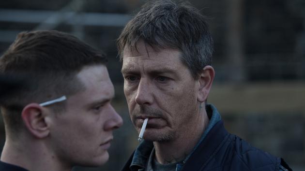 Australian Ben Mendelsohn (R) is unforgettable as Eric's dad Neville
