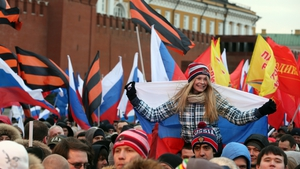 Russians attend a rally in Red Square, Moscow celebrating the result of the Crimean referendum (Pic: EPA)