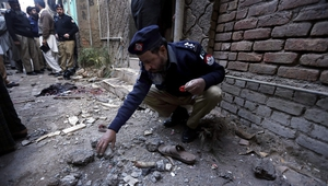Police inspect the scene of a bomb blast in Peshawar, Pakistan (Pic:EPA)