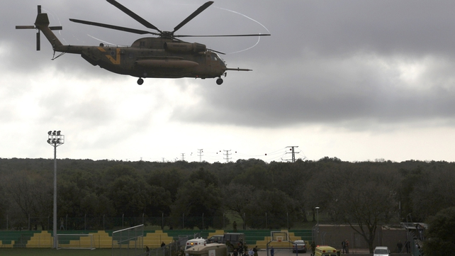 An Israeli military helicopter takes off carrying a soldier injured in yesterday's blast