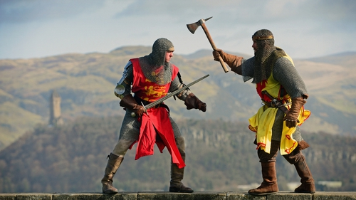 Men pose for pictures to promote a recreation marking the 700th anniversary of the Battle of Brannockburn