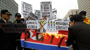 South Korean protesters burn a North Korean flag at a rally in Seoul