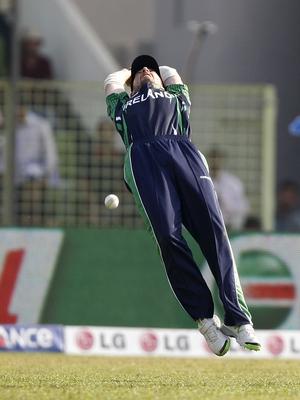 Ireland's Max Sorensen attempts a catch against Zimbabwe
