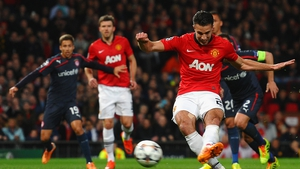 Robin van Persie scores the opening goal from a penalty kick