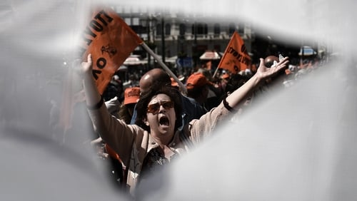 The Greek bailout agreement comes as civil servants stage a two-day strike in Athens
