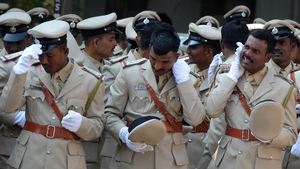 Members of India's Karnataka Industrial Security Force prepare for a group photograph after marching during a ceremonial parade