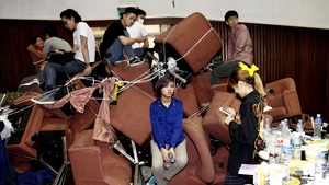 Students block an entrance to the Taiwanese parliament with sofas in protest at a trade deal with China