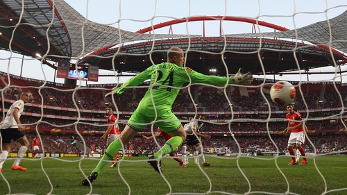 Ezequiel Garay of Benfica heads his side's opening goal past Brad Friedel