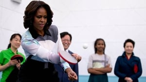 US First Lady Michelle Obama plays table tennis as she visits a school in Beijing