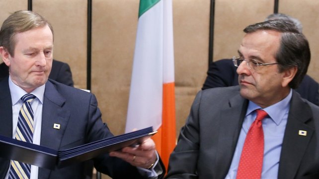 Taoiseach Enda Kenny (L) and Greek Prime Minister Antonis Samaras sign documents cementing the agreement (Pic: EPA)