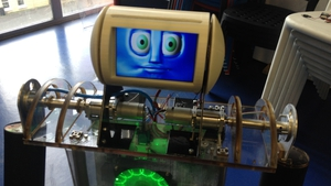 Robbie The Robot can be moved around using a computer, and can pick up small objects from the floor