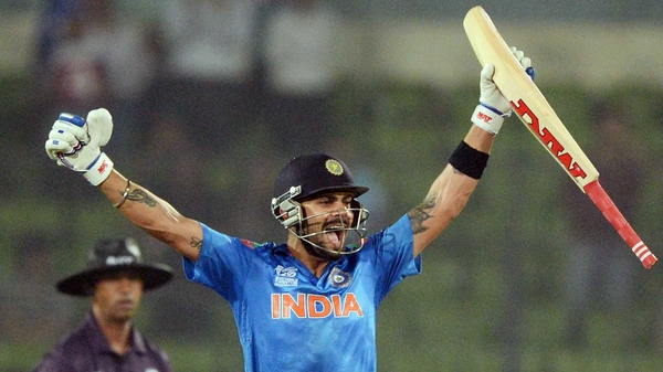 Virat Kohli celebrates after India eased to victory over Pakistan