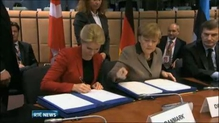 EU leaders sign an agreement signifying closer ties with Ukraine