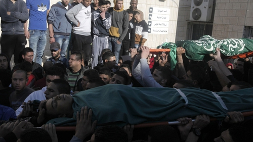 Palestinian men carry the bodies of comrades upon their arrival at an hospital in the Jenin refugee camp