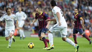 Andres Iniesta (C) vies with Real Madrid's Luka Modric (L) and Sami Khedira during last November's El Clasico