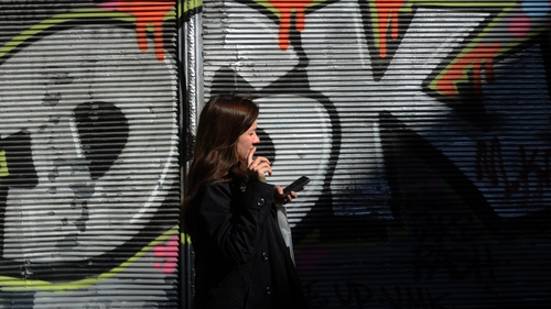 A woman uses her smartphone in Istanbul