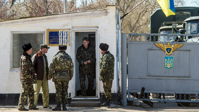 Ukrainian pilots and soldiers gather at the air base entrance in Fedorovka, Saki district, Crimea.