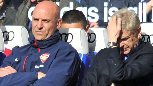 Misery written on the faces of Steve Bould and Arsene Wenger