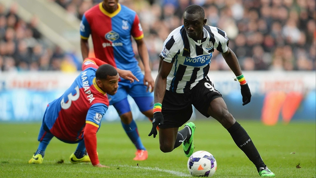 Papiss Demba Cisse goes past Adrian Mariappa of Crystal Palace