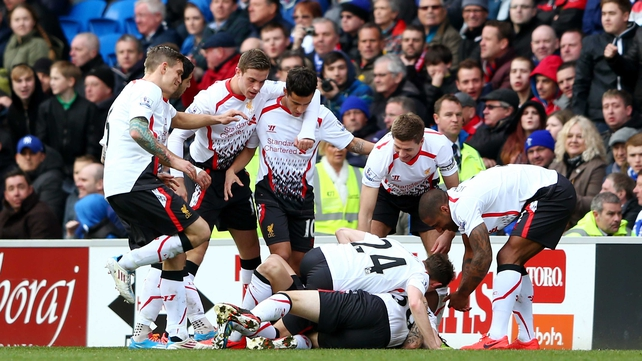 Martin Skrtel is mobbed after scoring Liverpool's third
