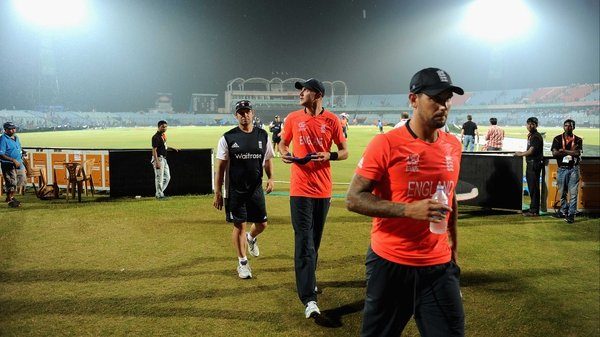 England captain Stuart Broad and Jade Dernbach leave the field as second rain shower stops play