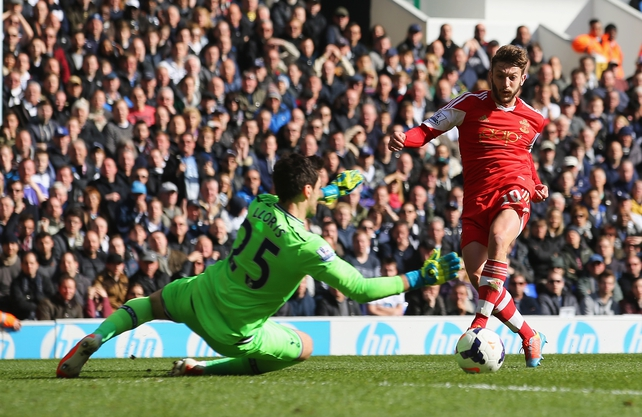 Adam Lallana of Southampton scores his team's second goal past Spurs' goalkeeper Hugo Lloris