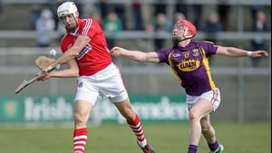 Willie Devereux strains to hook Cork's Patrick Cronin