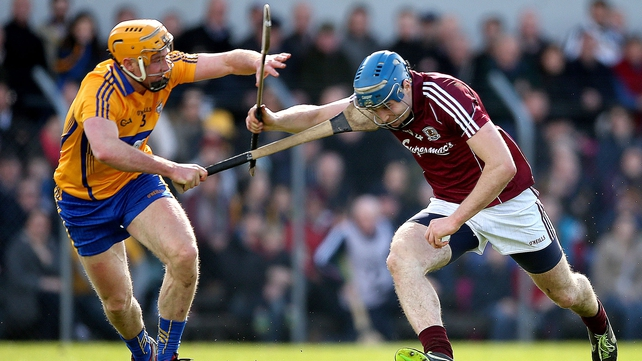 Cian Dillon and Conor Cooney battle for possession in Ennis