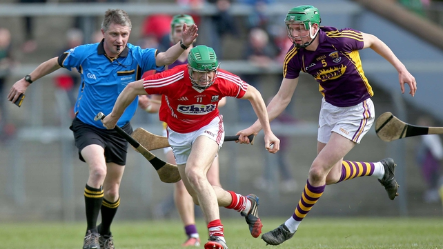 Cork's Seamus Harnedy pulls away from Liam Ryan of Wexford