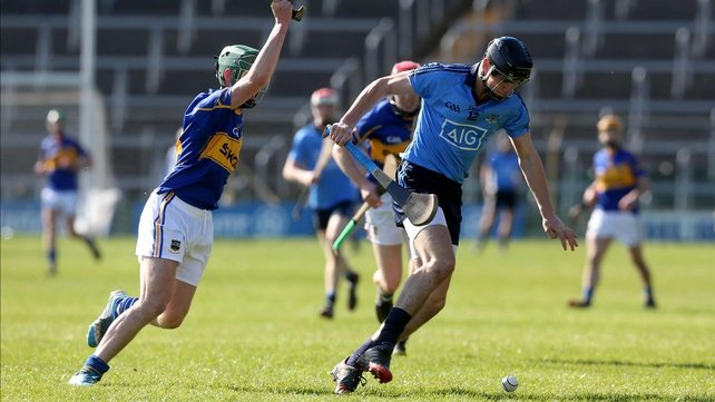 Tipp's Cathal Barrett goes in to disrupt Danny Sutcliffe's attempts to gain posession