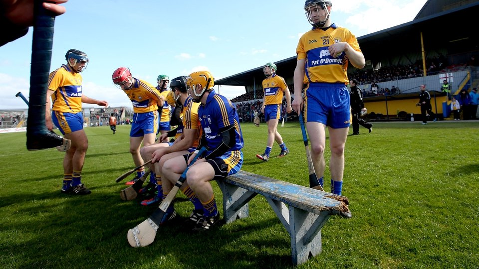 Someone's hurley enters frame left as Clare players prepare for their team photo