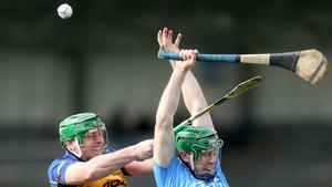 John O'Dwyer (left) challenges Johnny McCaffrey for the ball