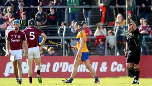 Referee Diarmuid Kirwan issues Shane Golden with a straight red card in Clare's clash with Galway