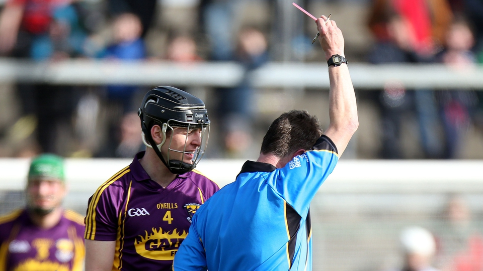 Bobby Kenny of Wexford is shown a straight red card by referee in Wexford's clash with Cork Barry Kelly