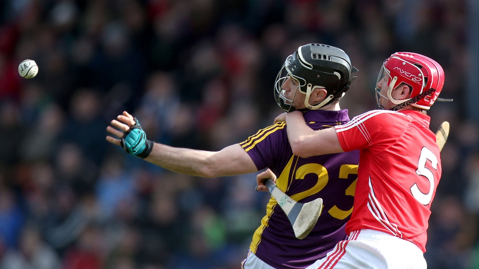'Out of hand': Lorcan McLaughlin and PJ Nolan compete for the sliotar
