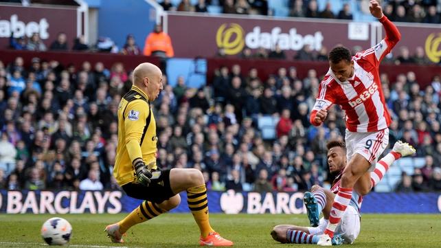 Peter Odemwingie scores past goalkeeper Brad Guzan to cancel out Aston Villa's opener