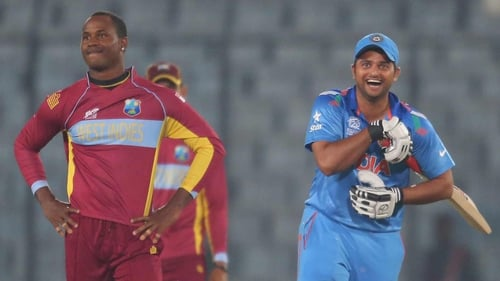 Suresh Raina (R) after hitting the winning runs for India