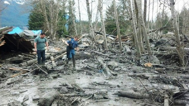 People examine debris after the mudslide in Snohomish County