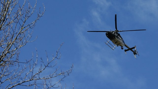 A Snohomish County Sheriff helicopter flies over the scene in Washington